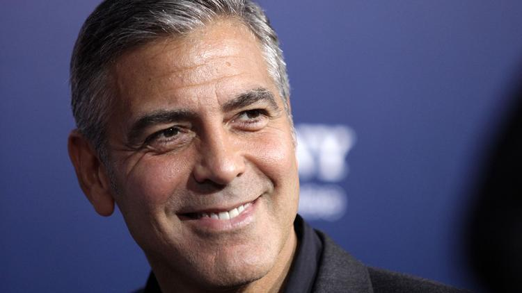 clooney in aurora prize ceremony